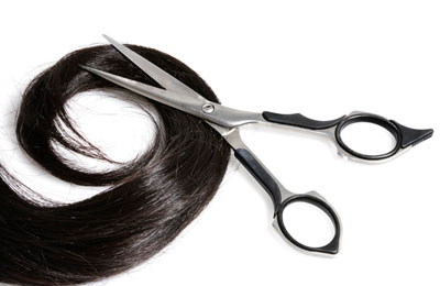 lock of hair with scissors